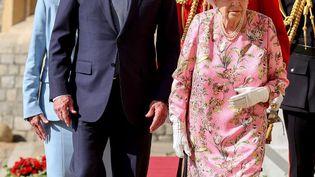 Le président américain Joe Biden et la reine Elizabeth II au chateau de Windsor, à l'ouest de Londres, le 13 juin 2021. (CHRIS JACKSON / AFP)