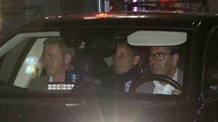 Nicolas Sarkozy quittel'Office central de lutte contre la corruption et les infractions financières et fiscales (OCLCIFF) à Nanterre (Hauts-de-Seine), mercredi 21 mars 2018. (STEPHANE MAHE / REUTERS)