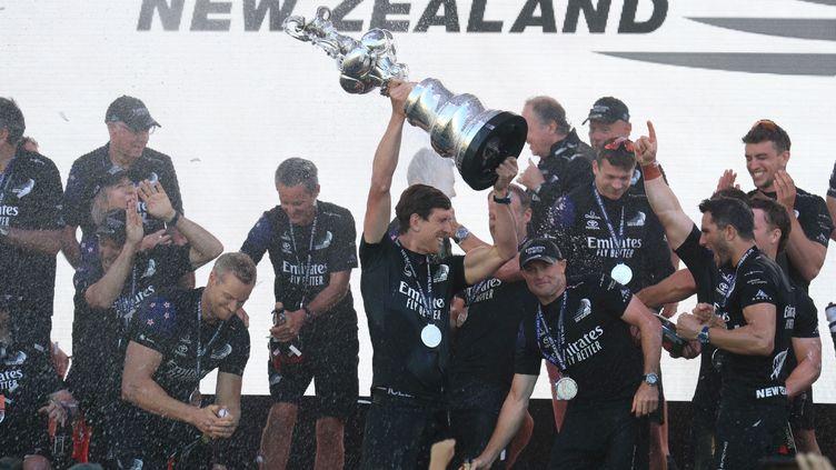 Team New Zealand, vainqueur de la Coupe de l'America 2021 à Auckland, le 17 mars 2021 (GILLES MARTIN-RAGET / AFP)