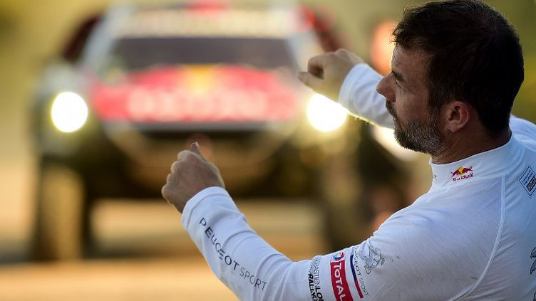 Pour son premier Dakar en carrière, Sébastien Loeb (Peugeot), nonuple champion du monde en Rallye WRC, a vécu deux Dakar différents : une première semaine exceptionnelle et une seconde ensablée...  (FRANCK FIFE / AFP)