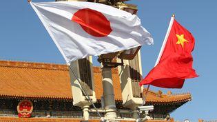 Les drapeaux du Japon et de la Chine flottantplace Tian'anmen, le 26 octobre 2018. (SUN JUN / IMAGINECHINA)