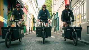 Trois livreurs d'Olvo, une entreprise decyclo-logistique créée il y a cinq ans et transformée depuis enSCOP, une société coopérative de production. (OLVO)