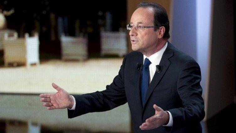 François Hollande annonce un taux d'imposition de 75% pour les hauts revenus (FRED DUFOUR / POOL / AFP)