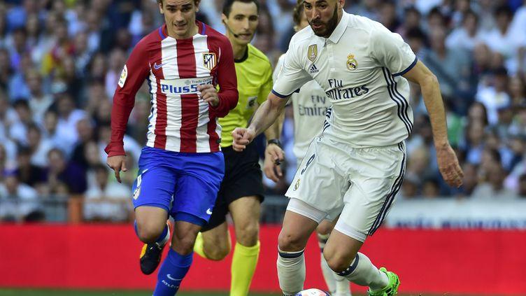 Antoine Griezmann face à Karim Benzema, un duel à suivre (GERARD JULIEN / AFP)