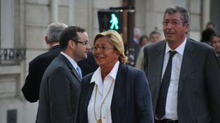 Isabelle Balkany et son mari Patrick arrivent à une réunion de l'UMP Jean-François Copé, le 4 septembre 2012 à Neuilly-sur-Seine (Hauts-de-Seine). (CITIZENSIDE / AFP)