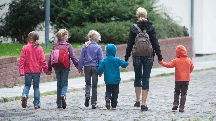 La baisse du plafond du quotient familial, annoncée le 3 juin 2013, concernera 1,3 million de ménages, soit 12% des ménages avec enfants. ( MAXPPP)
