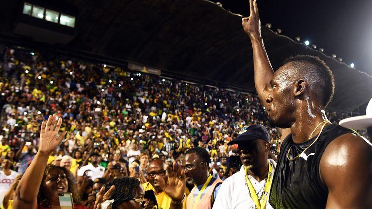 Usain Bolt a fait ses adieux au public jamaïcain (JEWEL SAMAD / AFP)