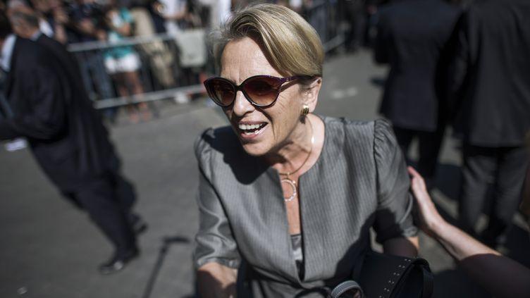 L'ancienne ministre Michèle Alliot-Marie arrive au siège de l'UMP, le 8 juillet 2013. (FRED DUFOUR / AFP)