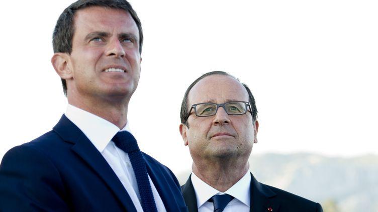 Le Premier ministre, Manuel Valls, et le président François Hollande, le 15 août 2014. (ALAIN JOCARD / AFP)