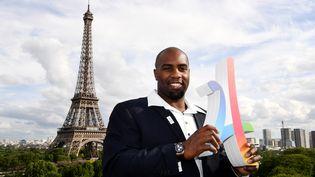Le judoka Teddy Riner soutient la candidature de Paris pour les JO 2024, le 14 mai 2017 à Paris. (FRANCK FIFE / AFP)