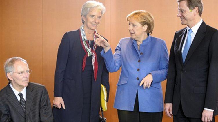 La ministre française de l'Economie Christine Lagarde mercredi aux côtés de membres du gouvernement allemand. (AFP)