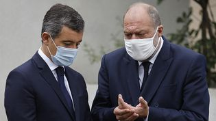 Gérald Darmanin et Éric Dupond-Moretti, le 25 septembre 2020. (LUDOVIC MARIN / AFP)