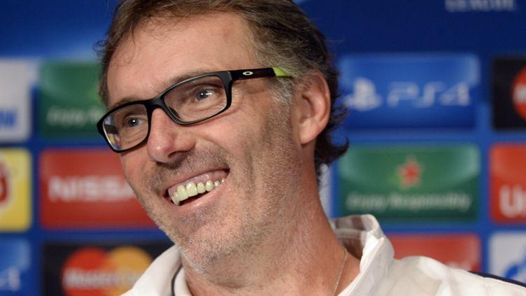 Laurent Blanc, l'entraîneur du PSG, en conférence de presse. (MIGUEL MEDINA / AFP)