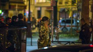 Une rescapée de l'attentat du Bataclan, la nuit du 13 novembre 2015  (Kamil Zihnioglu / AP / SIPA)