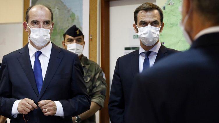 Le Premier ministre Jean Castex et le ministre de la Santé Olivier sont en déplacement en Guyane, le 12 juillet, pour faire le point sur la situation sanitaire. (JODY AMIET / AFP)