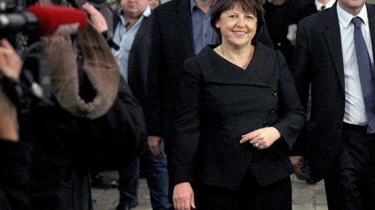 Martine Aubry a le sourire: le PS a réussi à devancer l'UMP au premier tour (AFP - THOMAS COEX)