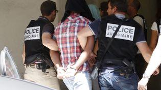 Cinq suspects dans l'affaire de l'assassinat d'Hélène Pastor viennent d'arriver au palais de justice de Marseille Marseille, le 27 juin 2014 (  MAXPPP)