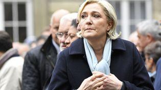 Marine Le Pen lors de la cérémonie d'hommage au policier tué sur les Champs-Elysées, mardi 24 avril 2017 à Paris. (BERTRAND GUAY / AFP)