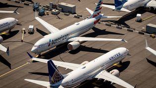 Les Boeing 737 MAX des compagnies américaines American Airlaines et United Airlines ici au sol en juillet 2019 à Seattle, peuvent redémarrer leurs vols en Europe. (GARY HE / EPA)