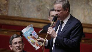 Nicolas Dupont-Aignan, député et président de Debout la France lors des questions au gouvernement, le 21 juin 2016 (THOMAS SAMSON / AFP)