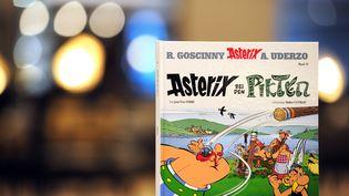 La couverture d'Astérix chez les Pictes, les nouvelles aventures du célèbre Gaulois, est dévoilée le 11 octobre 2013 à Francfort (Allemagne). (DANIEL REINHARDT / DPA / AFP)