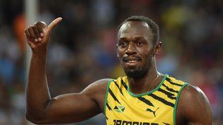 Le Jamaïcain Usain Bolt lors des Mondiaux d'athlétisme de Pékin (Chine), le 23 août 2015. (GREG BAKER / AFP)