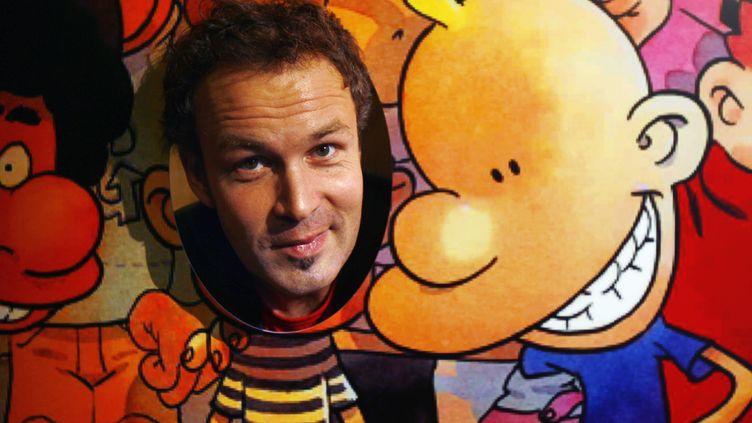 """Le dessinateur suisse Philippe Chapuis, alias Zep, pose le 4 octobre 2006 à Paris à côté de son personnage Titeuf, lors de la présentation du 11e album de la série, intitulé""""Mes Meilleurs Copains"""". (FRED DUFOUR / AFP)"""