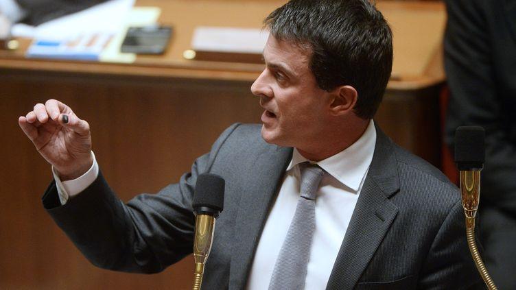 Le ministre de l'Intérieur, Manuel Valls, pendant une session de questions au gouvernement, à l'Assemblée nationale, le 12 novembre 2013. (BERTRAND GUAY / AFP)