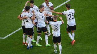 L'Allemagne célèbre le troisième but du match face au Portugal. (MATTHIAS HANGST / POOL)