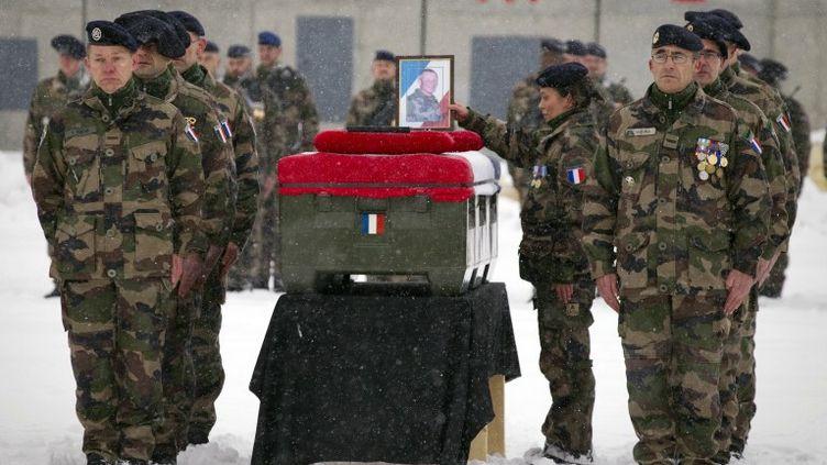 L'hommage aux quatre soldats français tués en Afghanistan, le 22 janvier 2012 à l'aéroport de Kaboul. (JOEL SAGET / AFP)