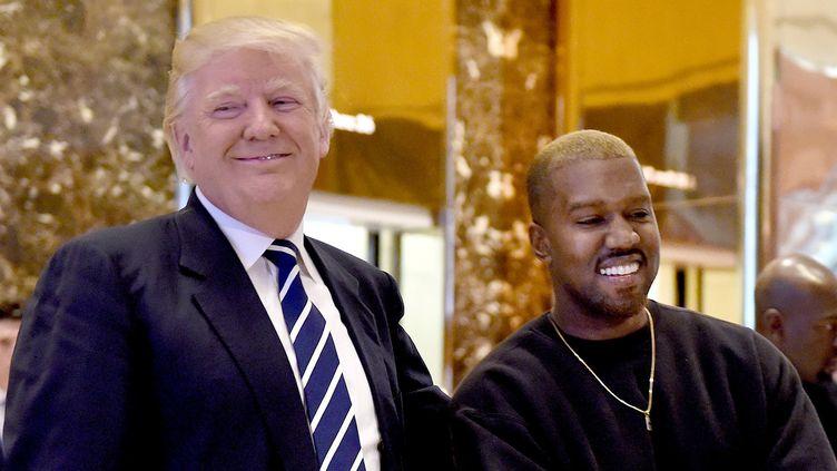 Kanye West avec Donald Trump devant la Trump Tower le 13 décembre 2016  (Timothy A. Clary / AFP)