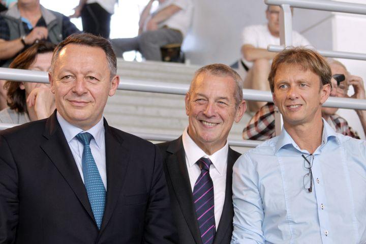 Lionel Horter (à droite), avec le ministre des Sports Thierry Braillard (à gauche), et le président de la Fédération française de natation, Francis Luyce, le 11 avril 2014. (CHARLY TRIBALLEAU / AFP)