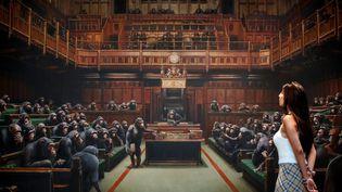 """""""Parlement décentralisé"""" (""""Devolved Parliament"""") dans Banksy (TOLGA AKMEN / AFP)"""