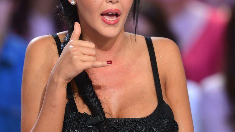 """Nabilla lors de l'émission """"Le grand journal"""", sur Canal +, le 11 avril 2013. (MIGUEL MEDINA / AFP)"""