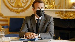 Le président de la République, Emmanuel Macron, à l'Elysée, le 21 juin 2021. (LUDOVIC MARIN / AFP)