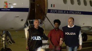 Au centre de la photo (prise en juin2016), on voit celui qui a été pris pour Medhanie Yehdego Mered, chef d'un importantréseau de trafiquants de migrants africains. Réseau ayant des ramifications en Erythrée, en Ethiopie, au Soudan, aux Emirats Arabes Unis, en Libye. (HO / AFP)