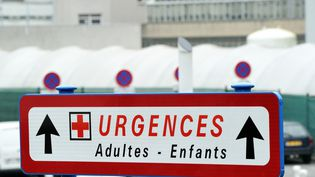 "A board informs on the location of ""cardiac emergencies"" department for adults and children at the Jeanne de Flandre hospital on January 30, 2014 in Lille, northern France. The hospital provides medical care for children and families. AFP PHOTO PHILIPPE HUGUEN (Photo by Philippe HUGUEN / AFP) (PHILIPPE HUGUEN / AFP)"