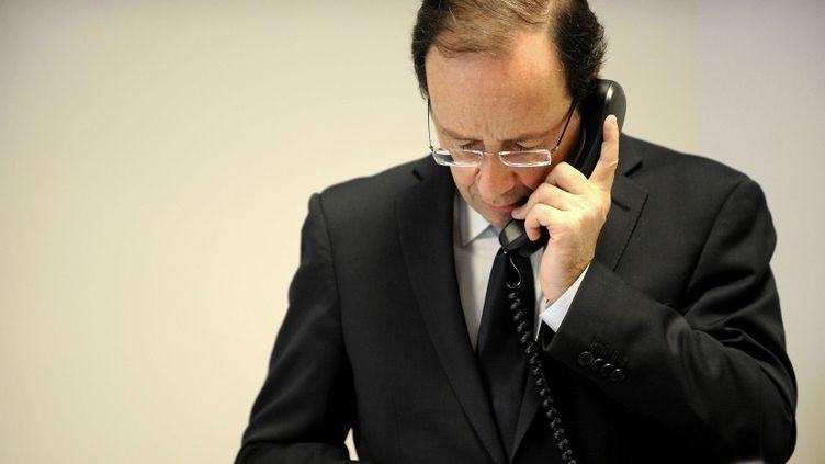 (François Hollande, Angela Merkel, Vladimir Poutine et Petro Porochenko se sont entretenus au téléphone pendant deux heures ce dimanche. © PHOTOPQR/OUEST FRANCE/Joël Le Gall)