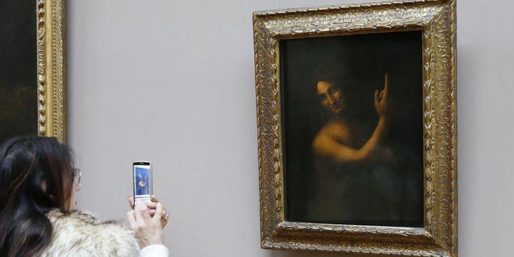 Le Saint Jean Baptiste de Léonard de Vinci au Louvre avant sa restauration  (Patrick Kovarik / AFP)