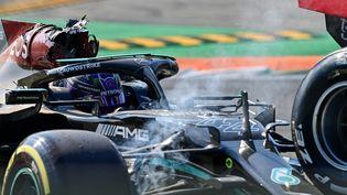 Lewis Hamilton (Mercedes), après son accrochage avec la Red Bull de Max Verstappen, le 12 septembre 2021. (ANDREJ ISAKOVIC / AFP)