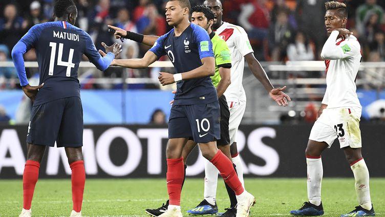 Matuidi et Mbappé (ANNE-CHRISTINE POUJOULAT / AFP)