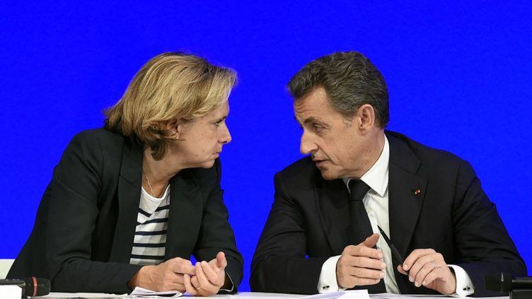 Valérie Pécresse, candidate à la primaire de la droite pour la présidentielle 2022 et Nicolas Sarkozy, président de la République entre 2007 et 2012. (ALAIN JOCARD / AFP)
