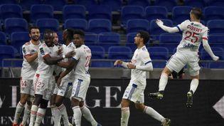 L'équipe de l'Olympique lyonnais au stadeDécines-Charpieu (Rhône), le 8 novembre 2020. (JEAN-PHILIPPE KSIAZEK / AFP)