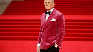 """Daniel Craig à la première mondiale de """"Mourir peut attendre"""" au Royal Albert Hall de Londres le 28 septembre 2021 (TOLGA AKMEN / AFP)"""