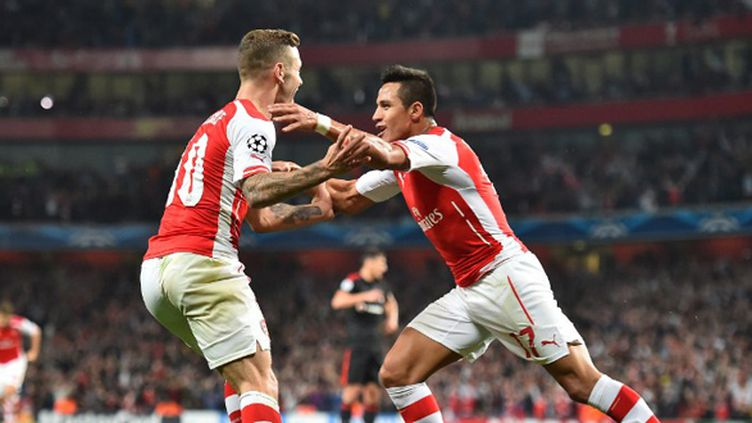 Jack Wilshere félicite Alexis Sanchez (BEN STANSALL / AFP)