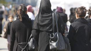 Une femme voilée au Bourget (Seine-Saint-Denis), lors de la Rencontre annuelle des musulmans de France, le 6 mars 2010. (FRED DE NOYELLE/GODONG / PHOTONONSTOP / AFP)