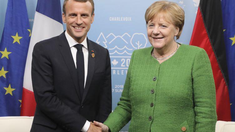 Emmanuel Macron et Angela Merkel, le 8 juin 2018. (LUDOVIC MARIN / POOL)