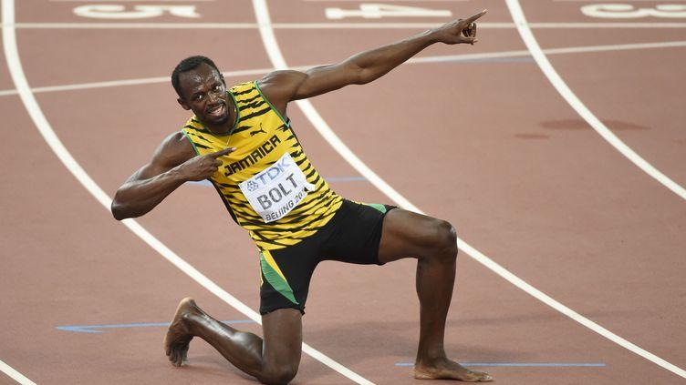 Usain Bolt, après sa victoire au 200 mètres lors des championnats du monde d'atlhétisme à Pékin. (PHILIPPE MILLEREAU / KMSP)
