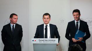 Olivier Dussopt, Gérald Darmanin et Benjamin Griveaux, à Paris, le 27 mars 2019. (LUDOVIC MARIN / AFP)