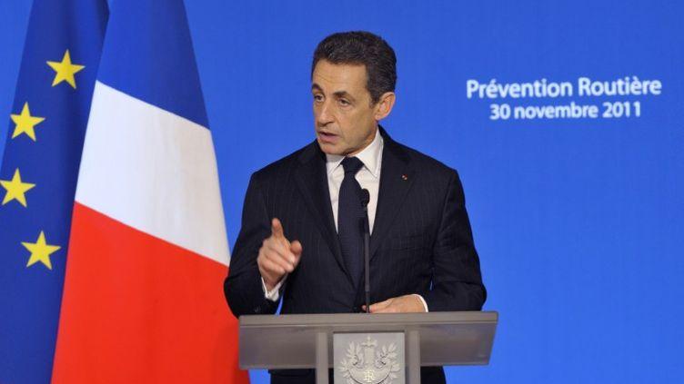 Nicolas Sarkozy à l'Elysée lors de la remise des Echarpes d'or de la prévention routière, le 30 novembre 2011. (PHILIPPE WOJAZER / POOL / AFP)